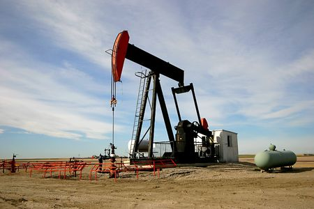 oilwell: An oil pump jack in Southern Alberta.