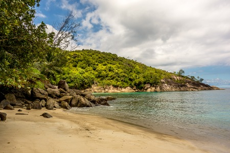 beach landscape: Rocks on the beach in Mahe Seychelles main island