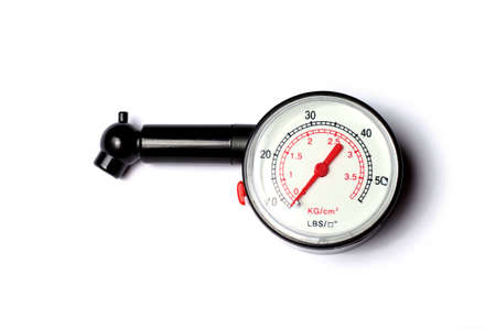 Plastic tyre-pressure gauge on white background Stock Photo