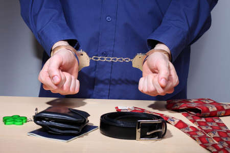 Businessman with handcuffs, stripped of personal items during arrest Stock Photo - 6782809