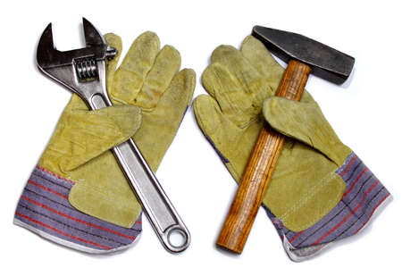 Hammer, crescent wrench and pair of work gloves Stock Photo