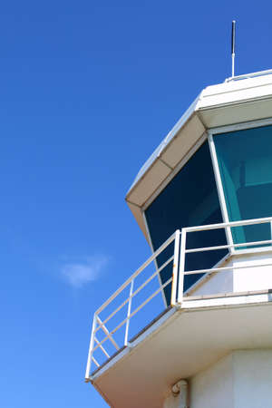 air traffic: Part of aerodrome control tower against clear sky, with copyspace