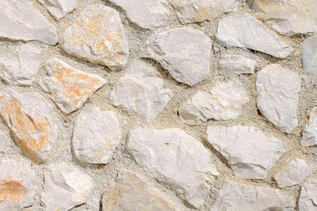 Rough stone wall background Stock Photo