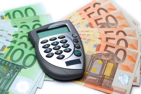 Bank card reader, internet banking authorization device lying on some euro bills Stock Photo