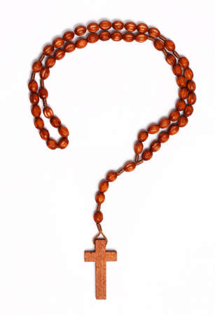 Question mark outline made from wooden rosary on white background