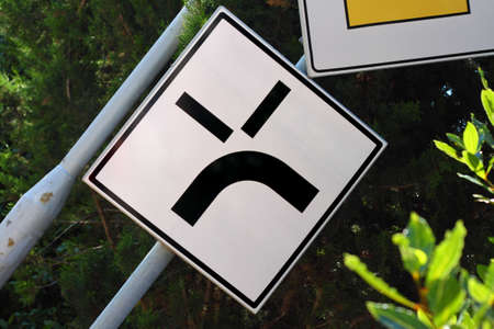 Traffic sign resembling angry human face, road rage concept