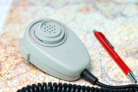 ATC microphone and red ballpoint pen on aeronautical chart