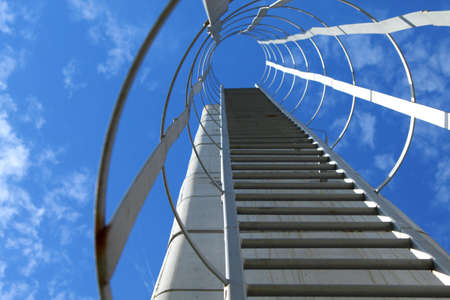 Industrial metal ladder, sky is the limit Stock Photo