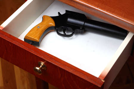 forgotten: Flare gun forgotten in old desk drawer Stock Photo