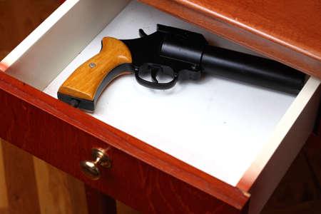 drawers: Flare gun forgotten in old desk drawer Stock Photo