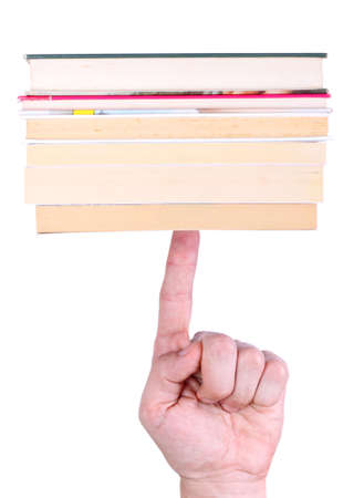 Stack of books balanced on finger Stock Photo