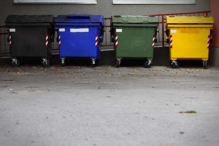 Four colored garbage bins to help separate and recycle