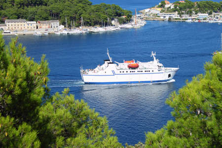Ferryboat entering port of Mali Losinj, Croatia