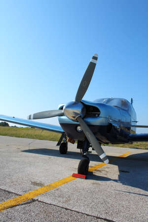 fixed wing aircraft: Propeller-driven airplane parked on tarmac Stock Photo