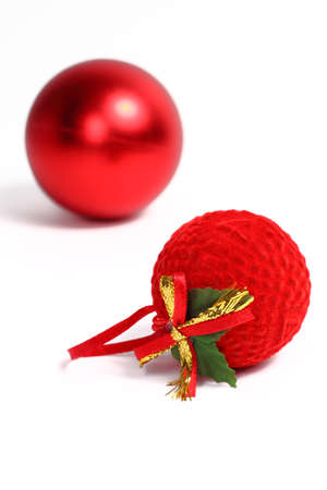 Two red balls, Christmas ornaments, isolated on white background