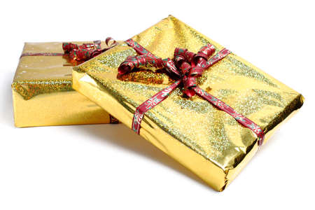 Two boxes in golden gift wrapping