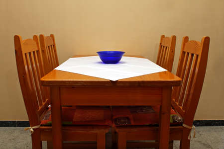 dining table and chairs: Rustic old dining room table and chairs Stock Photo