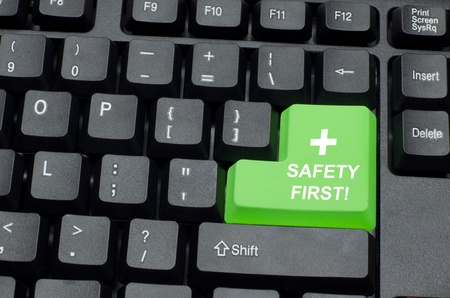 health dangers: safety first word on green and black keyboard button Stock Photo