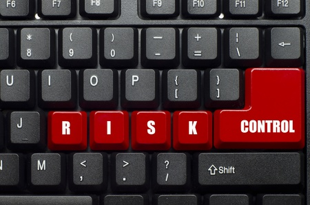 risk control word on red and black keyboard button
