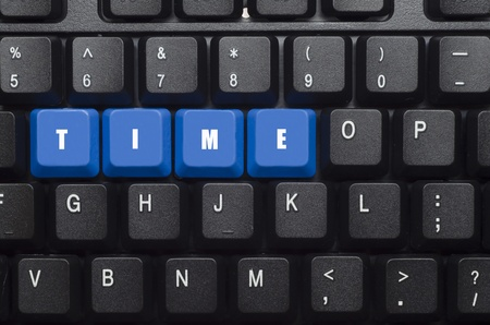 time word on blue and black keyboard button photo