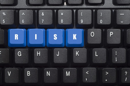 risk word on blue and black keyboard button photo