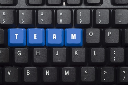 team word on blue and black keyboard button photo