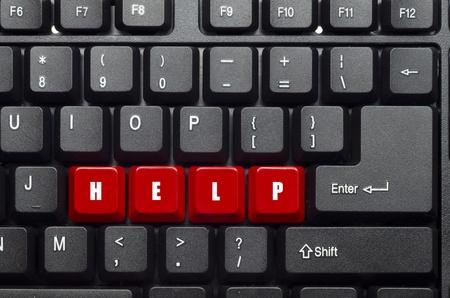 helpen woord op rood en zwart toetsenbord toets