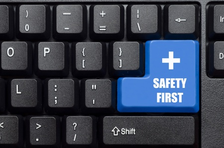 safety first word on blue and black keyboard button