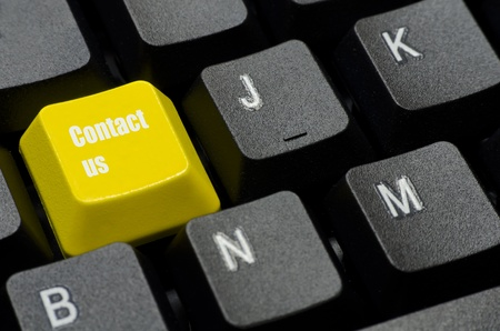 contact us words on yellow and black keyboard button photo