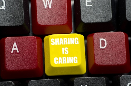 sharing is caring phrase on yellow keyboard button