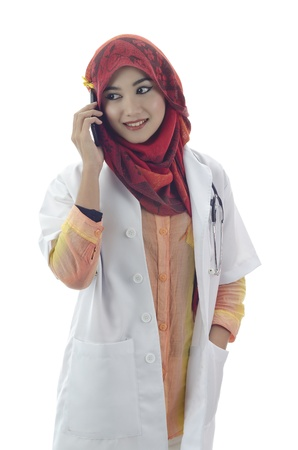 beautiful young muslim woman doctor with stylish head scarf make a phone call isolated on white background Stock Photo - 11904894