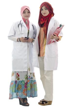 twee mooie arts op een witte achtergrond Stockfoto
