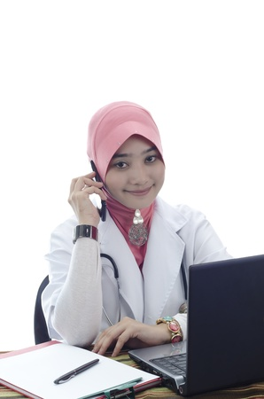 beautiful young muslim woman doctor with head scarf make a phone call isolated on white background photo