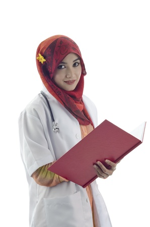 beautiful muslim medical doctor woman holding red book isolated on white background