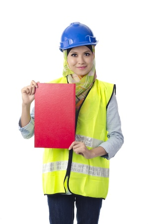 Beautiful muslim woman with personal protective equipment holding red note book Stock Photo