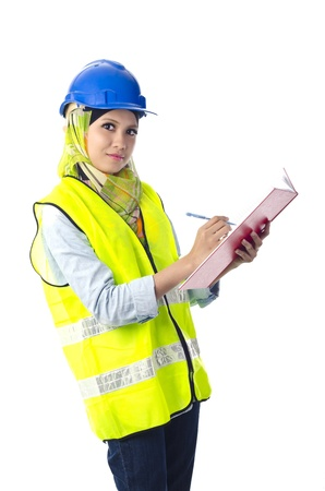 Beautiful muslim woman with personal protective equipment writting on red note book Stock Photo
