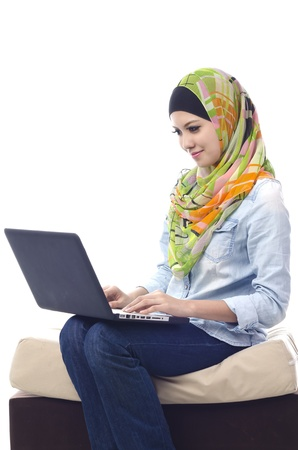 muslim baby girl: Beautiful muslim woman smiling chat with her friends using computer