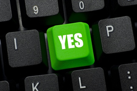 injunction: yes word on green and black keyboard button Stock Photo