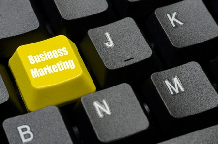 business marketing words on yellow and black keyboard button photo