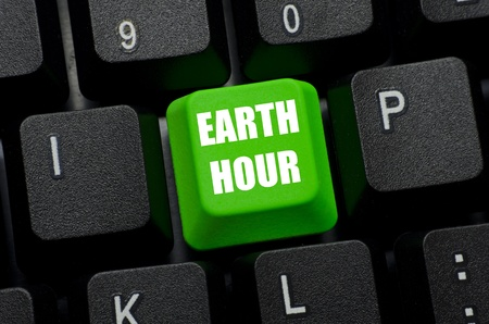 earth hour on green and black keyboard button photo