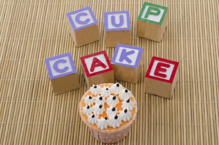 cup cake with wood blocks on bamboo mat