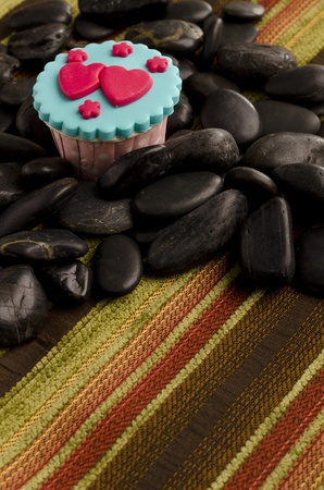 cup cake with black stones photo