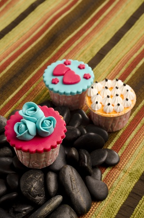 the various type of cupcakes with black stones photo