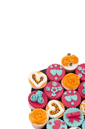 colorfull cup cakes with on black plate