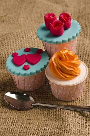 Colorfull cup cake with spoon on canvas mat