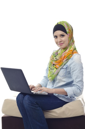 Beautiful muslim woman smiling chat with her friends using computer Stock Photo - 11986929