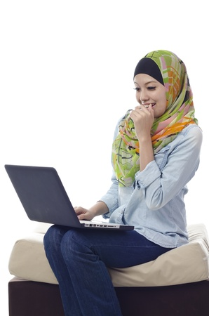 Beautiful muslim woman happy and laugh during chat with her friends using computer