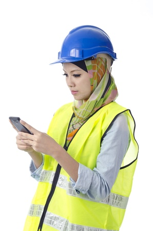 muslim baby girl: Beautiful muslim woman with personal protective equipment send message using phone Stock Photo