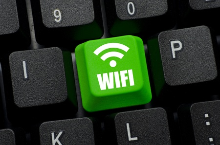 wifi word icon on green and black keyboard button photo