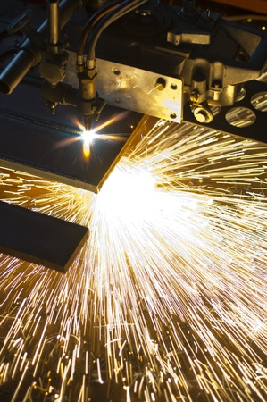 orange hot sparks from industry auto cutter plate machine photo